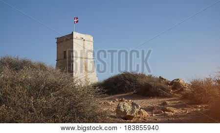 A typical Maltese knight tower on the cliff on the island of Malta Ghajn Tuffieha Tower