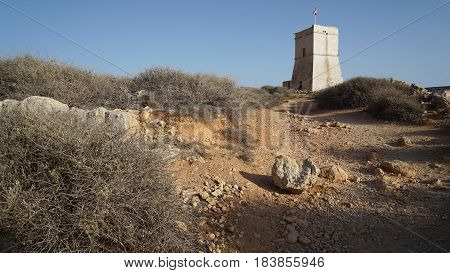 Panoramic view of Maltese typical knight tower on the sky background