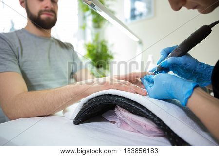 Close-up of man's hands at beautician's during manicure
