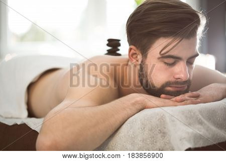 Man Relaxing During Lastone Therapy