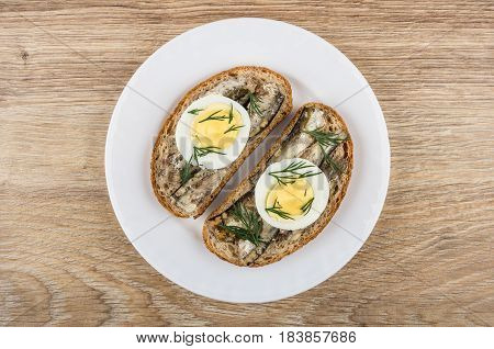 Sandwiches With Sparts In Oil, Eggs And Dill In Plate