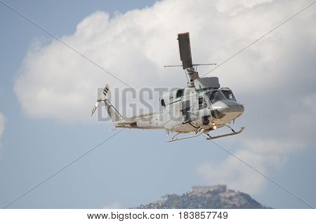 Black hawk helicopter rescue team.Approach landing right machine gun view. Exhaust gases