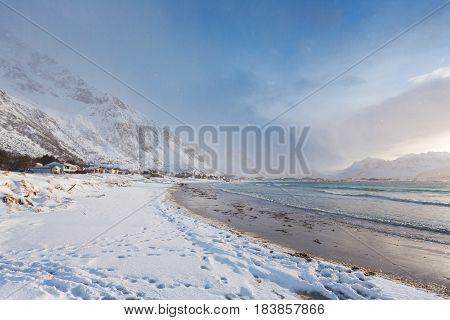 The snowy beach of the Lofoten Islands in winter