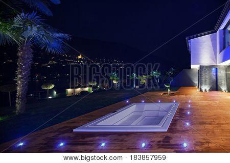 Exteriors of modern luxury villa in the night