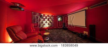 Film room in a private house, red walls
