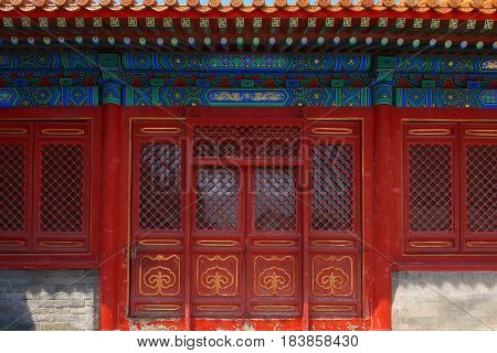 Gateway with red Chinese doors closeup photo