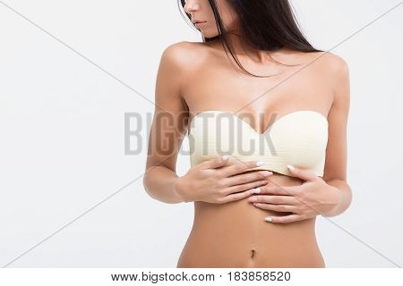 Young beautiful girl with magnificent breasts chic.