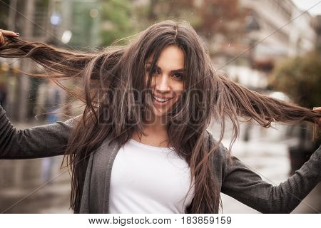 Happy Cheerful Smiling Woman Enjoys On The City Streets
