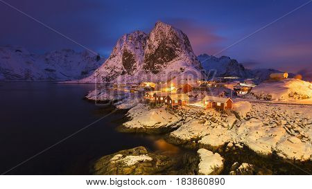 Snowy Hamnoy village in the Lofoten islands at night