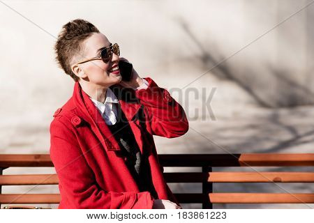 Cheerful Girl Speaks By Phone In The Afternoon