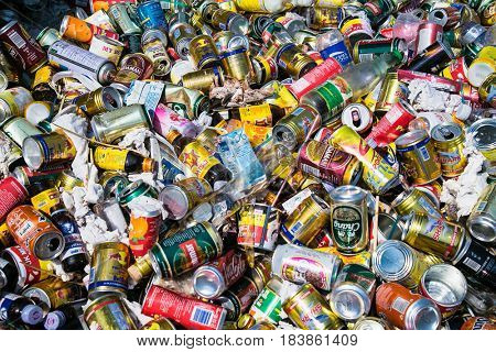 KALAW, MYANMAR-MARCH 5,2017: Background of various crashed beer cans and botle on March 5, 2017, Kalaw Myanmar.