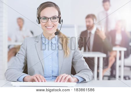 Telemarketer With Colleagues