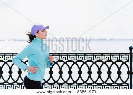 The Girl Is Running Along The Embankment