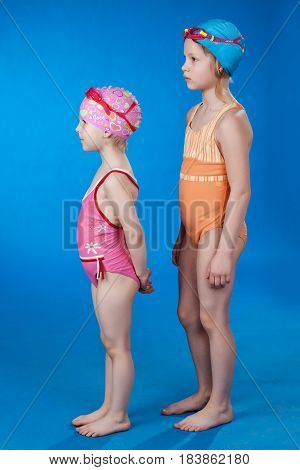 Sisters in a bathing suit partying on a blue background