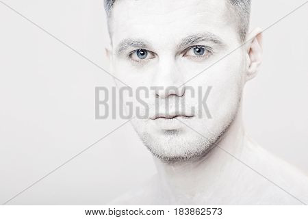 portrait of a young man with white face paint. Professional Fashion Makeup. fantasy art makeup
