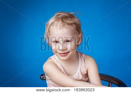 Portrait of a smiling girl on a blue background