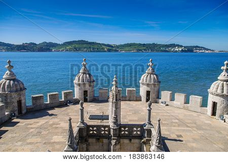 Belem terrace with white stone towers and the view of Atlantic ocean, Lisbon, Portugal