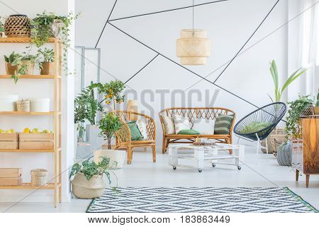 White botanic living room with rattan furniture set