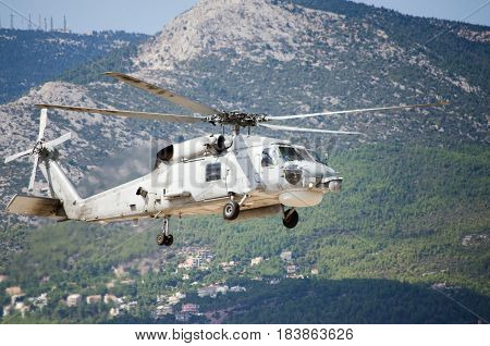 Black hawk helicopter rescue team,approach landing exhaust gas mountain background