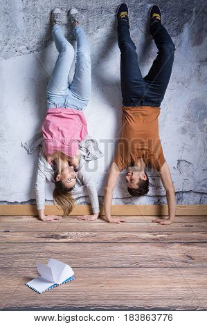 Smiled Couple Doing Handstand