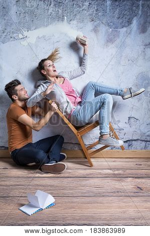 Overturning Chair With Young Woman