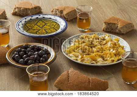 Traditional Moroccan  breakfast with bread, eggs,olives,olive oil and mint tea