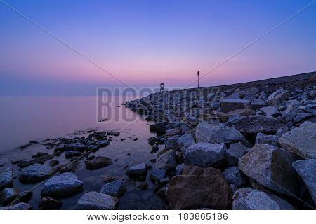 beautiful sea in twilight time and rock pier