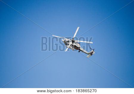 Black hawk helicopter rescue team.Fly maneuvering nose up blue sky background