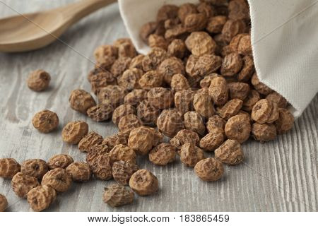 Sack with unshelled raw tiger nuts