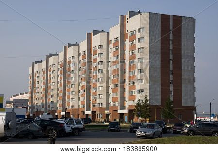 New Urengoy, YaNAO, North of Russia. August 10, 2013. Modern multi-storeyed building from white and orange brick