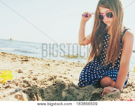 Lovely Gorgeous Little Girl Playing With Sand.