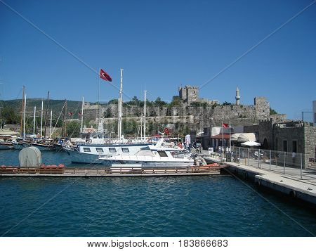 Bodrum, Turkey - July 12, 2014: Marina Bodrum - Boats in the harbor, castle background