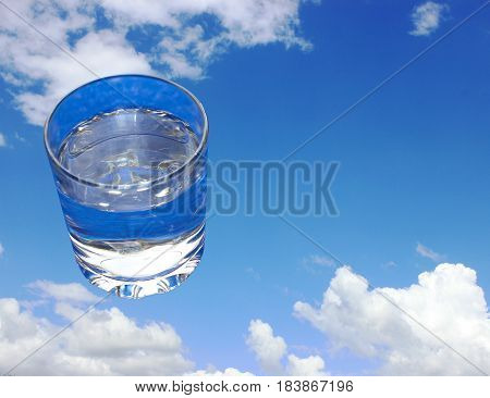 Goblet filled with clean drinking water, heavenly background as an advertisement