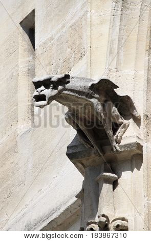 A gargoyle in Saint-Jacques Tower. Paris, France