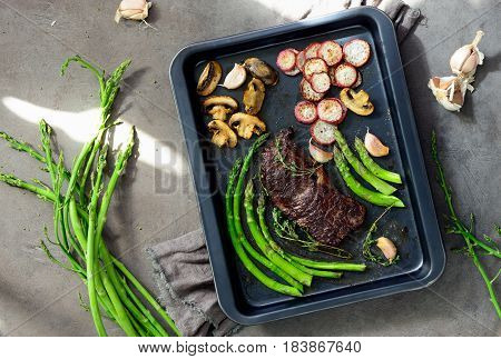 roasted; roast; food; root; vegetable; view; healthy; top; red; black; cooking; baked; background; dish; cuisine; fresh; garlic; closeup; overhead; diet; beef; rustic; dinner; green; natural; cooked; organic; ingredient; farm; kitchen; old; sunday; meal;