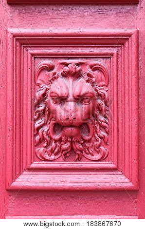 Lion head engraved on a wooden door