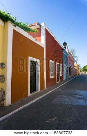 Vertical view of a colorful colonial street in Valladolid Mexico