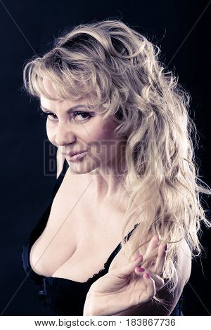 Sexiness of women. Attractive sensual blonde adult woman on dark background. Sexy beauty middle aged lady.