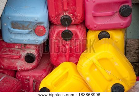 Heap of red yellow blue dirty plastic canisters for bulding priming