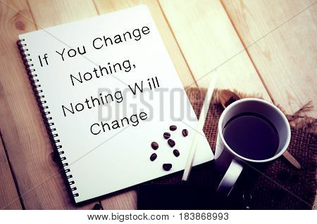 Inspiring motivation quote handwritten on a note pad if you change nothing. Nothing will change. White pad paper image.