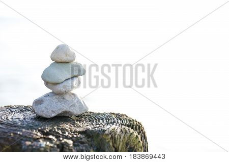 Cairn on a pier post on Lake Michigan.