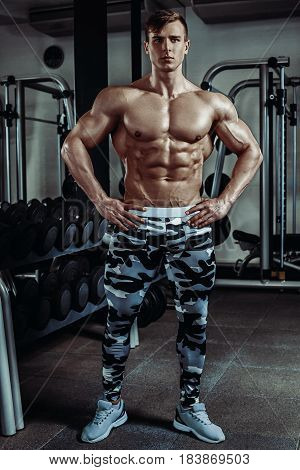 Strong muscular bodybuilder doing exercise in the gym. Part of fitness body. Sports and fitness. Fitness man in the gym. Fitness training