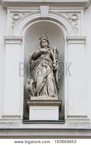 ZAGREB, CROATIA - APRIL 26: Saint Catherine of Alexandria statue on the facade of St. Catherine church in Zagreb, Croatia on April 26, 2014.