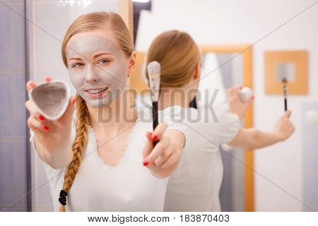 Girl Holding Clay Mud Mask And Brush. Skin Care.