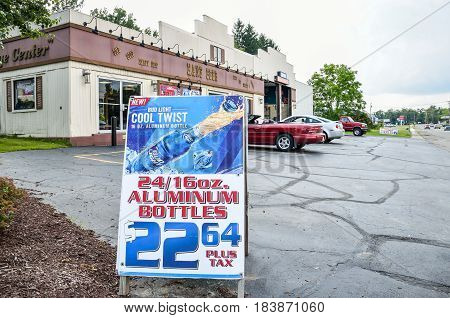 Kane USA - July 21 2014: Bud light aluminum bottles sign by beer store in town