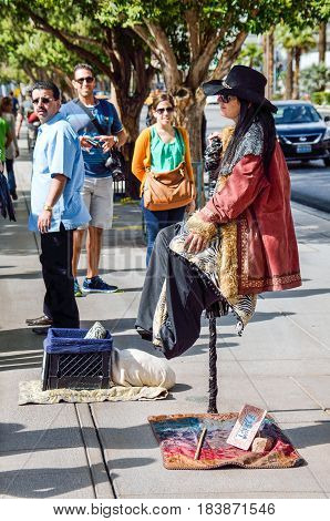 Las Vegas USA - May 7 2014: Street performer magician sitting suspended in air holding a cane