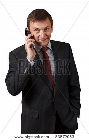 Confident Mature Businessman  Speaking On The Sell Phone On White Isolated Background