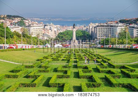 Hedge maze park forming a long perspective to Marquis of Pombal square in Lisbon, Portugal