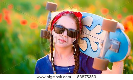Young Hipster Girl With Braids In Sunglasses And A Red Sash On Her Head, Listening To Music With A L