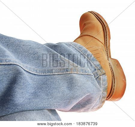 Man's boots and jeans isolated on white. Wearing dirty boots isolated on white.